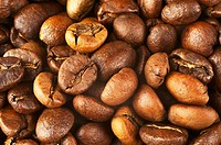 Natural background from roasted coffee beans. Macro shot with tilt effect.