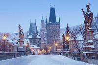 Prague - Charles Bridge tower nad St. Nicolas church on winter morning.