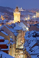 Czech Republic, Prague - Old Town Hall tower and roofs the Old Town in winter.