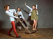 Young girls having fun in the Studio. They are trendy long shirts and coats. The collection of clothes is provided by a known fashion designer from Be...