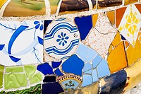 Close up of mosaic tiles on the benches in the main square (Plaça de la Natura) of Parc Guell, Barcelona - Catalonia, Spain.