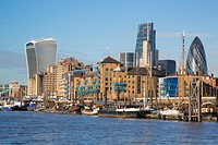 A view of London and some of the skyscrapers in the square mile and the river Thames in the foreground.