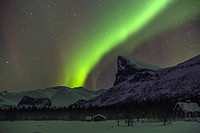 Northern light, Aurora borealis, over Sarek national park taken from Aktse, with an old barn and house, Mount Skerfe and Namatj, slightly movement in ...