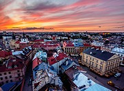 Poland, Lublin Voivodeship, City of Lublin, Old Town, Elevated view of the Market Square at sunset.