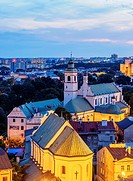 Poland, Lublin Voivodeship, City of Lublin, Old Town, Elevated view of the churches of Peter the Apostle and the Conversion of St Paul at twilight.