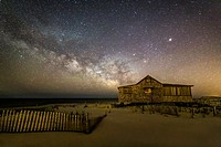 NJ Shore Starry Skies and Milky Way - Island Beach State Park at the NJ Shore with beach fences leading to the Judge´s Shack underneath a starry sky w...