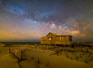 New Jersey Shore Starry Skies and Milky Way - Island Beach State Park at the NJ Shore with beach fences leading to the Judge´s Shack underneath a star...