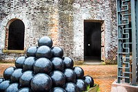 Huge stacks of canon balls on displays in an old Fort. Fort Macon State Park, originally called, Fort Dobbs then Fort Macon Military Reservation, is o...