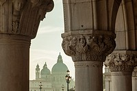 Afternoon in the sestier of San Marco, Venice, Italy. Santa Maria della Salute church in the distance.
