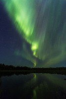 Northern Light, Aurora borealis, reflecting in a lake, Gällivare, Swedish Lapland, Sweden.