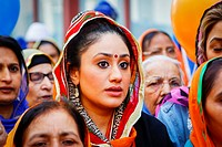 A Sikh woman, in the crowd at the religious celebrations of Vaishakhi, the Spring Festival, Glasgow, Scotland, UK.