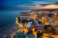 Panoramic landscape at dusk beaches, hotels and the Carihuela, Torremolinos. Malaga province Costa del Sol. Andalusia Southern Spain, Europe.