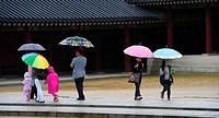 People under umbrella visit Changdeokgung Palace,Seoul,South Korea.