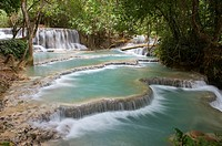 Cascades and turquoise blue pools of the Kuang Si Falls near Luang Prabang in Laos.