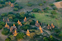 View of temples from a hot air balloon flying over Bagan, Myanmar in the early morning.