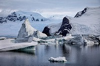 Icebergs, glaciers and mountains along the waters of the Antarctic Peninsula.
