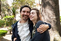 couple hugging in Parque Mexico in Mexico City, Mexico.