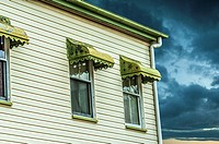 A Queenslander house in an approaching storm.