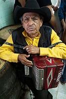 A man with an accordion in a pulqueria in Xochimilco, Mexico City, Mexico.