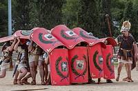 Live reenactment of Roman Legionnaires in defensive combat position during 'Tarraco Viva' festival, Tarragona, Catalonia, Spain. The annual festival p...