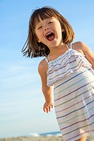 Four year old having fun at the beach, La Jolla, California.