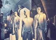 Mannequins and reflections at a window shop in Gran Via avenue. Madrid. Spain.