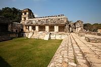 Visitors in front of the Palace-El Palacio at the Patio de los Cautivosin Palenque Archaeological Site, Palenque, Chiapas State, Mexico, Central Ameri...