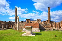 Ruins of the Forum of Pompeii with Volcano Vesuvius in the background, Campania, Italy.