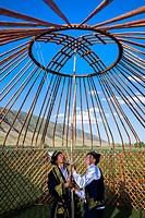 Kazakh men putting up a yurt, For editorial Use only, Sati village, Tien Shan Mountains, Kazakhstan.