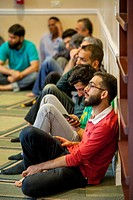 Young Muslim men gather for Friday afternoon prayers during religious services at an Anaheim, CA, mosque.