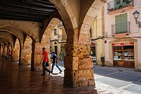 Stone gothic arches on Merceria street. Tarragona old town, Catalonia, Spain.