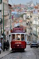 red vintage tramway streetcar Alfama street Lisbon Portugal.