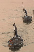 fisher on his boat on Thu Bon river Hoi An Vietnam.