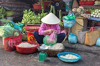 street market vegetables woman soja Hoi An Vietnam.
