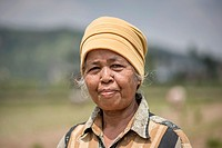 Portrait of a female rice field worker at the Harau Valley, Sumatra, Indonesia.