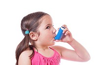Little sick girl using medical spray for breath. Isolated over white background.