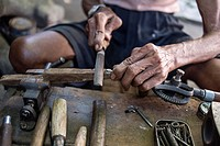 Senior Carpenter at work in his workshop in Yogyakarta, Java, Indonesia.