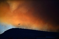 Helicopter fighting wildfire in Yosemite area, California, United Staes.