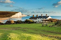 Coastguard Cottages and Seven Sisters cliffs in East Sussex, England. South Downs National Park.