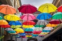 Street art display, hanging umbrellas, Caudan Waterfront, Port Luis, Mauritius. Caudan Waterfront is a commercial centre in Port Luis, the capital cit...