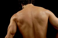 studio photography of a man with His back,.