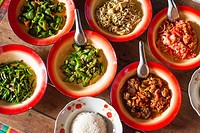 Bowls of food in small village in Myanmar.