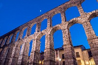 Partial view of the Roman aqueduct located in the city of Segovia at night , Unesco World Heritage Site, Spain.
