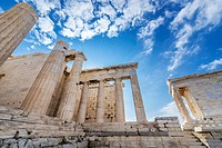 Monumental gateway called Propylaea, entrance to the top of Acropolis of Athens city, Greece. Temple of Athena Nike on right.