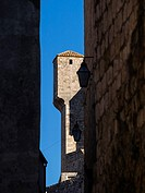 Croatia, Dubrovnik, defensive wall architecture against Blue sky through narrow street.