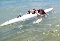 Alibi girl on top of a surfboard, Denia, Spain.