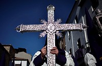 A man holds a silver cross during Easter Week celebrations in Baeza, Jaen Province, Andalusia, Spain.