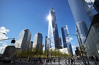 looking up at sun reflecting off one world trade center from national september 11th memorial site New York City USA.