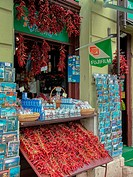 Red chillies and turquoise postcards for sale at tourist kiosk near Budapest Cathedral, Budapest, Hungary.