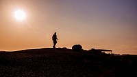 A tourist photographer takes pictures of the enchanting scenery at sunset, Petrified Forest National Park, Arizona, USAPetrified Forest National Park,...